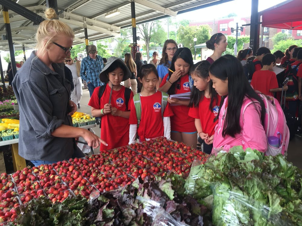 Burns Park Elementary students participating in a MyPlate lesson at Kerrytown Farmers Market, Ann Arbor Public Schools. (This photo was taken by Neha Shah and is courtesy of Nathan Luis Medina)