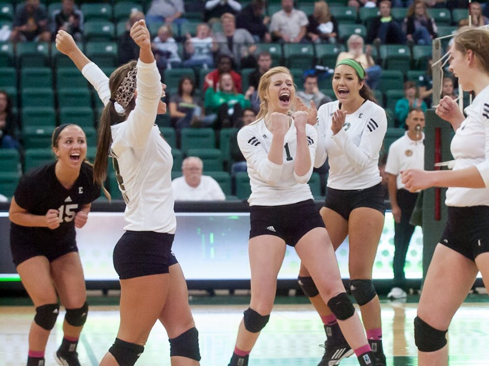 The Eastern Michigan volleyball team celebrates winning a set during the Eagles' loss to Northern Illinois on 10 October at the Convocation Center in Ypsilanti.