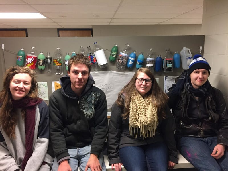 Four students placed artistic displays around Pray-Harrold as part of a collaborative project to promote recycling and sustainability on campus. From left to right: Abigail Vermeulen, Raley McCrea, Kacey Greaves, Ethen Click