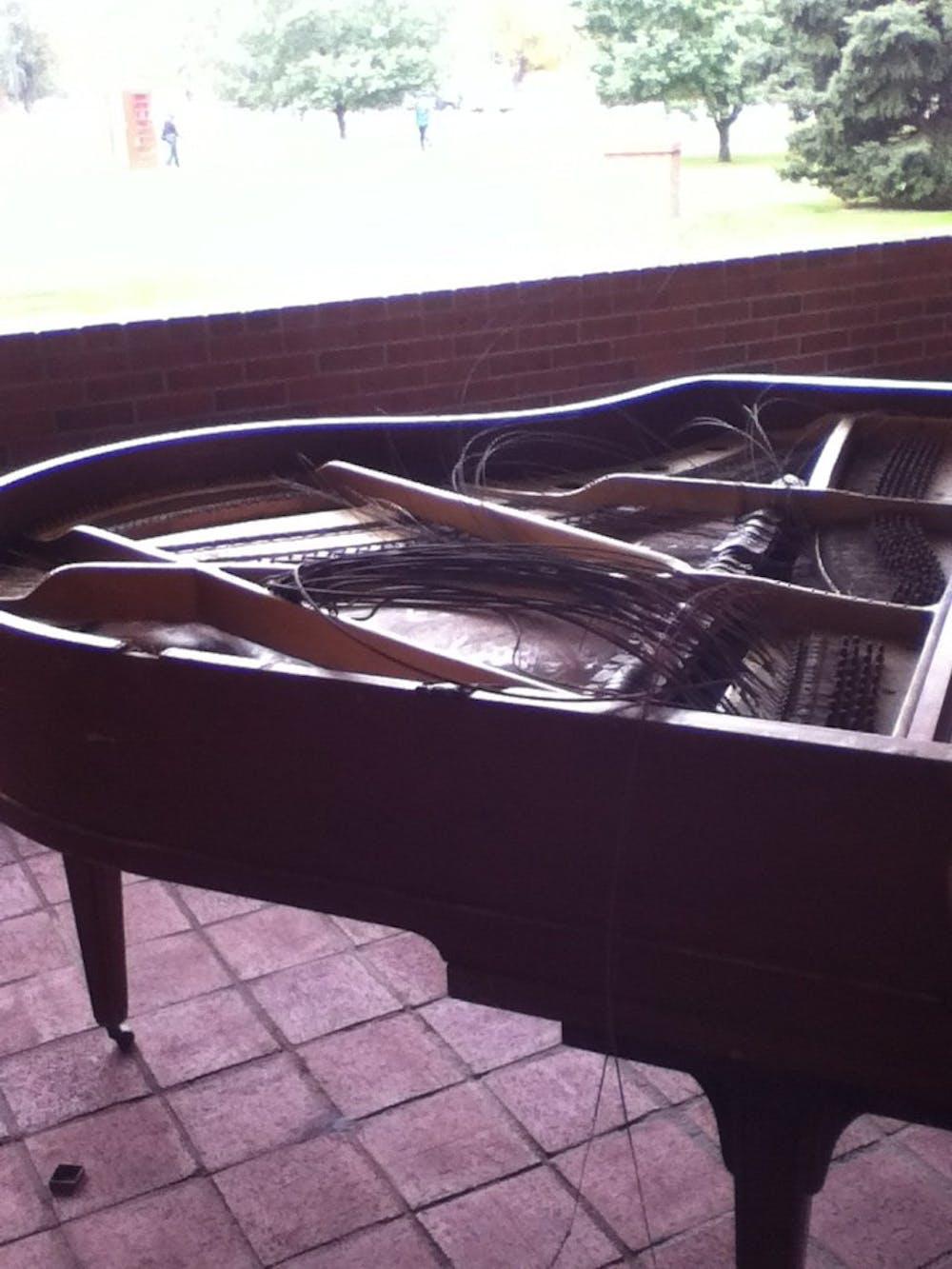 Broken piano awaits smashing