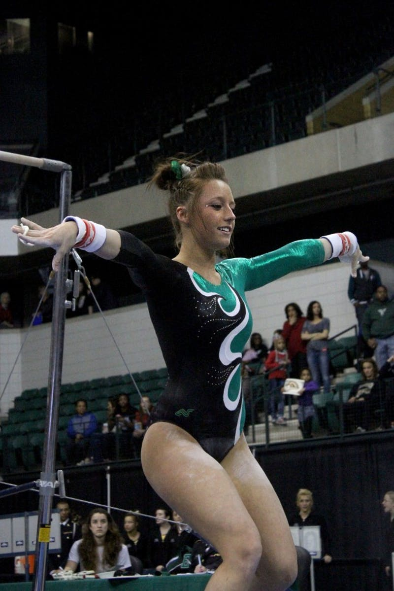 Anna Willette competes on uneven bars during the MAC Conference Championships at Eastern Michigan University's Convocation Center in Ypsilanti on Saturday, on March 22, 2014.