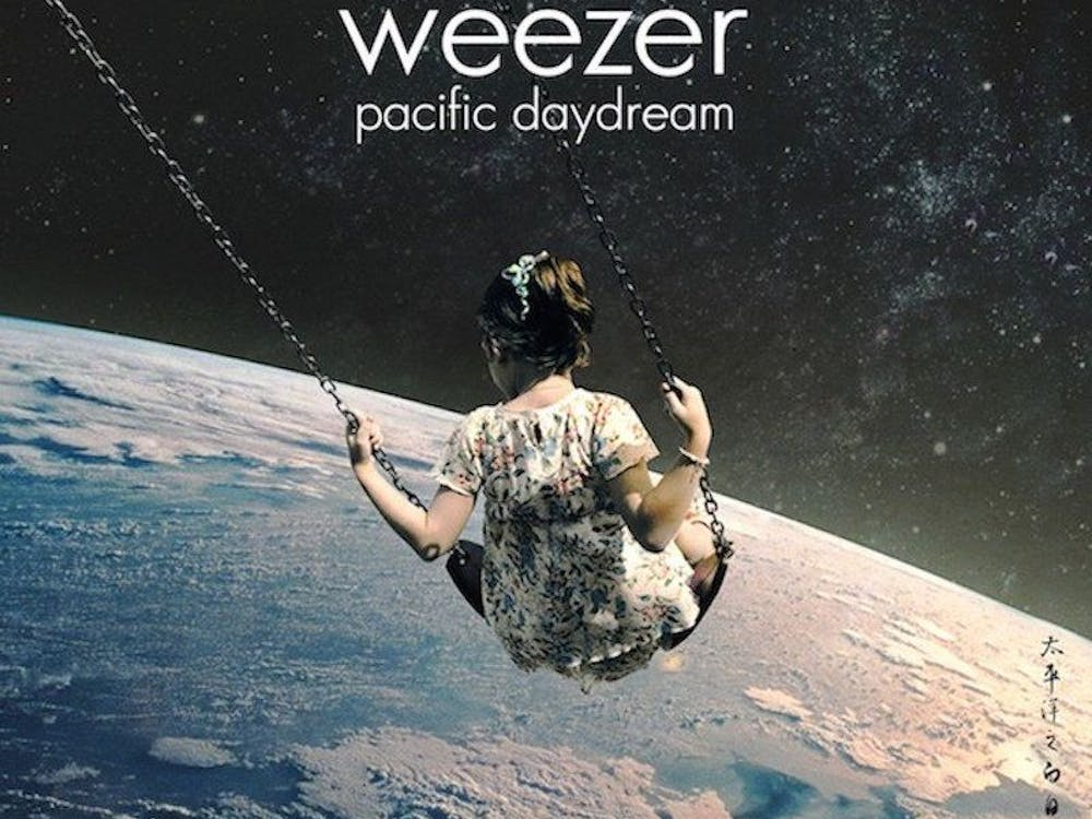 """At this point in time, Weezer has been around, and mostly active, for quite a while. Releasing its first album in 1994, which went triple platinum, it has never been very far from the starlight. While it often bobs up and down the surface of popularity, Weezer has never settled on just what kind of music it wants to make. Its music has ranged from being oddly experimental to being acutely radio friendly. On its latest album, """"Pacific Daydream,"""" we see another shift in the band's style back to being acutely radio friendly, for better or for worse."""