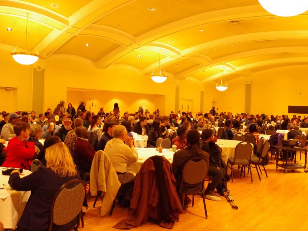 "Audience members sitting in the McKenny Hall Ballroom for the ""Know Justice, Know Peace"" day-long teach-in at Eastern Michigan University discussing racism, diversity and inclusion on Monday, Nov. 14."
