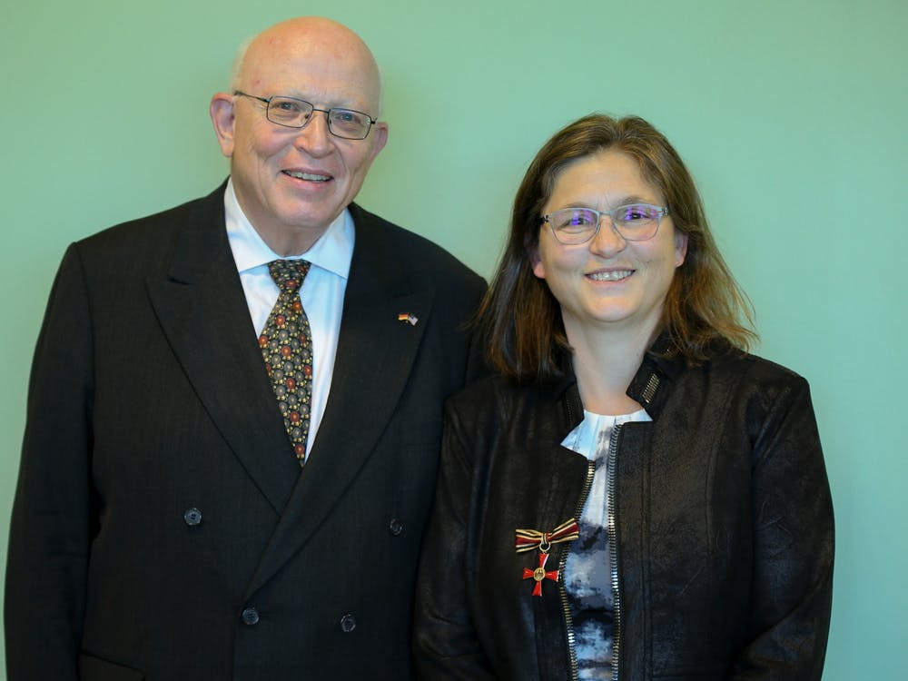The honor was presented to professor Damiano by the Consul General of the Federal Republic of Germany, Wolfgang Moessinger. (Photo courtesy of Eastern Michigan University Professor Carla Damiano.)