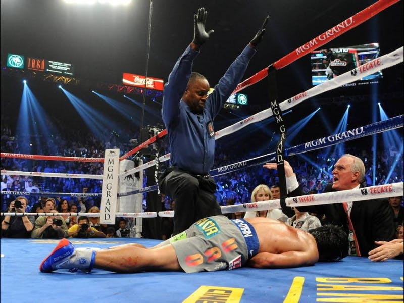 "Manny ""Pacman"" Pacquiao sprawled out on the canvas following a devastating right hand blow from Juan Manuel Marquez on Saturday."