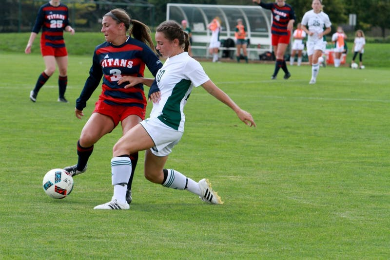 Sabrina McNeill dribbles the ball against Detroit Mercy on Sept. 18.