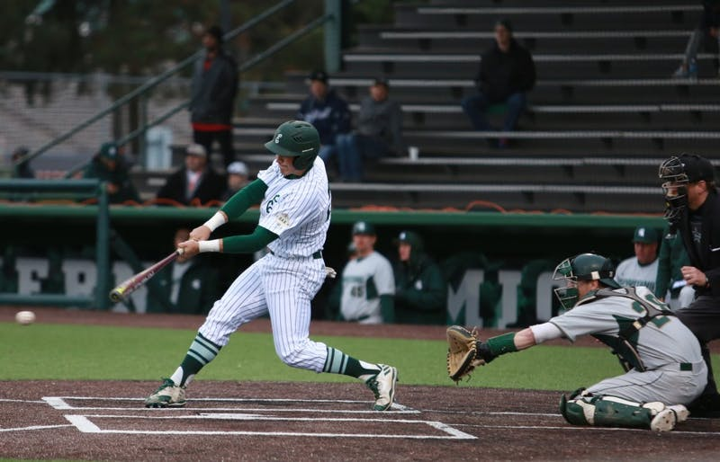 Zachary Owings hits the ball against Michigan State April 4 at Oestrike Stadium.