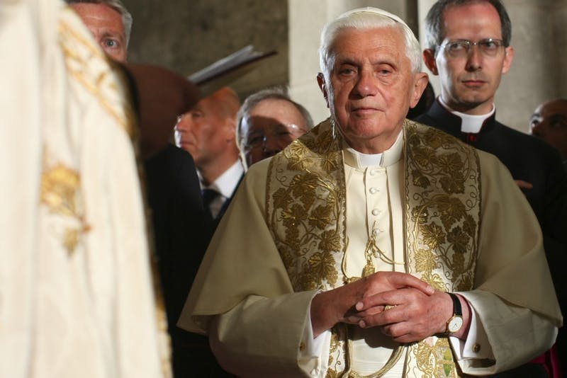 Pope Benedict XVI prays on the Stone of Anointing, where Jesus' body is said to have been prepared for burial after crucifixion, in the Church of the Holy Sepulchre in Jerusalem, Friday, May 15, 2009.