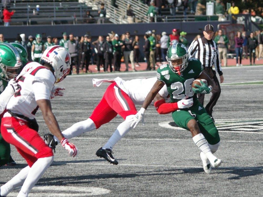 EMU running back Willie Parker runs through Ball State defense at Rynearson Stadium on Oct. 12.
