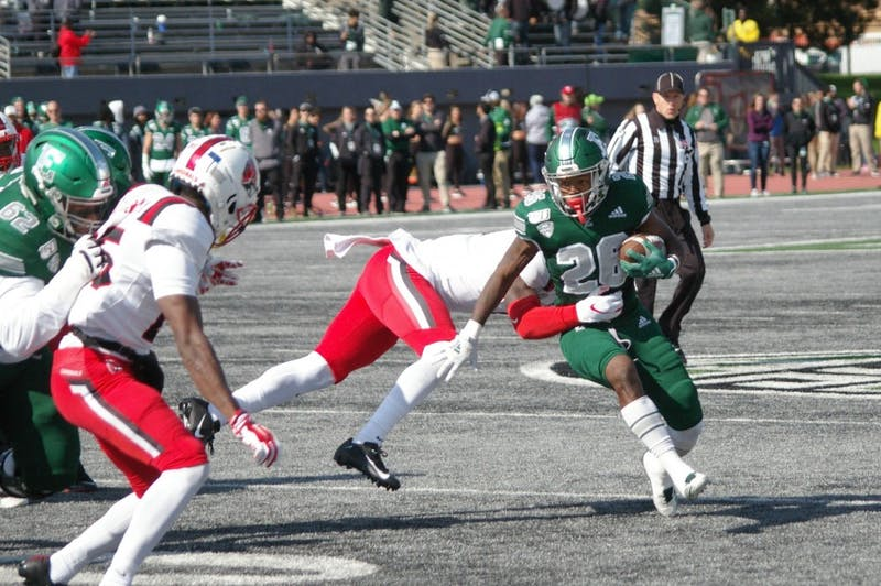 EMU running back Willie Parker runs through Ball State defense at Rynearson Stadium on Oct. 12.
