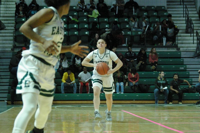 EMU guard Jenna Annecchiarico passes ahead to Courtnie Lewis at the Convocation Center on Nov. 8.