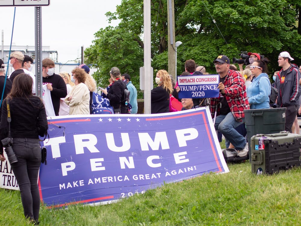 A 2016 Trump presidential campaign banner during a Trump welcome rally on May 21, 2020. The president visited the Ford Rawsonville Components Plant in Ypsilanti on Thursday afternoon.
