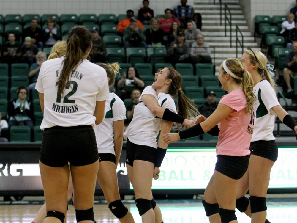EMU celebrates against Ball State at the Convocation Center in Ypsilanti on Oct. 10.