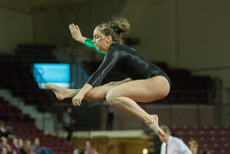 Rachel Slocum jumps and poses on Jan. 17 at McGuirk Arena.