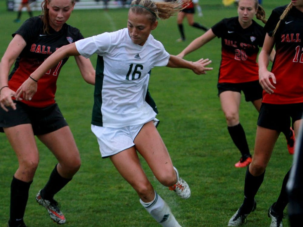 Ellie Tillar fights for the ball against Ball State at Scicluna Field in Ypsilanti on Sept. 30.