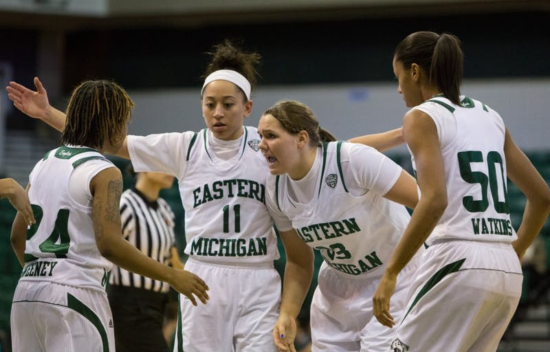 EMU forward Olivia Fouty (33) rallies the team in the first half of Eastern Michigan's 83-77 win over Western Michigan Wednesday night.