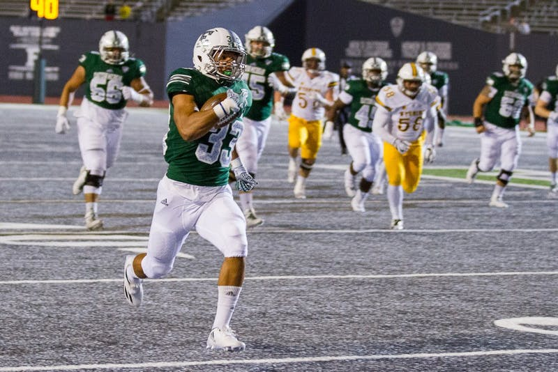 EMU running back Breck Turner rushes for a touchdown during the Eagles' 27-24 win over Wyoming.