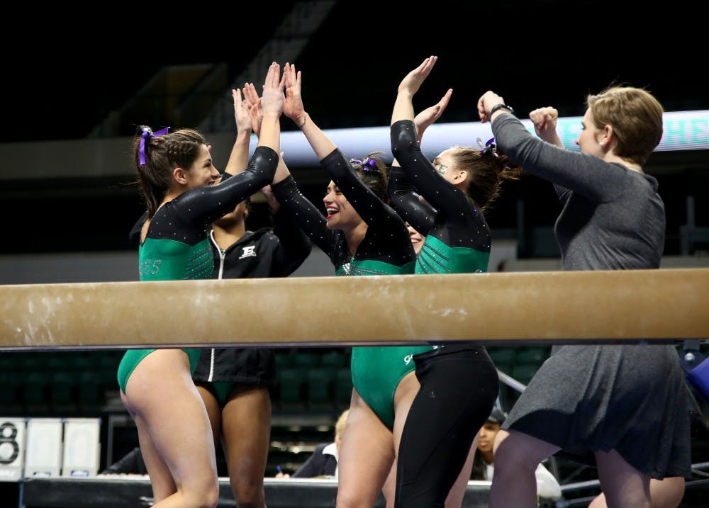 EMU gymnastics starts season with win