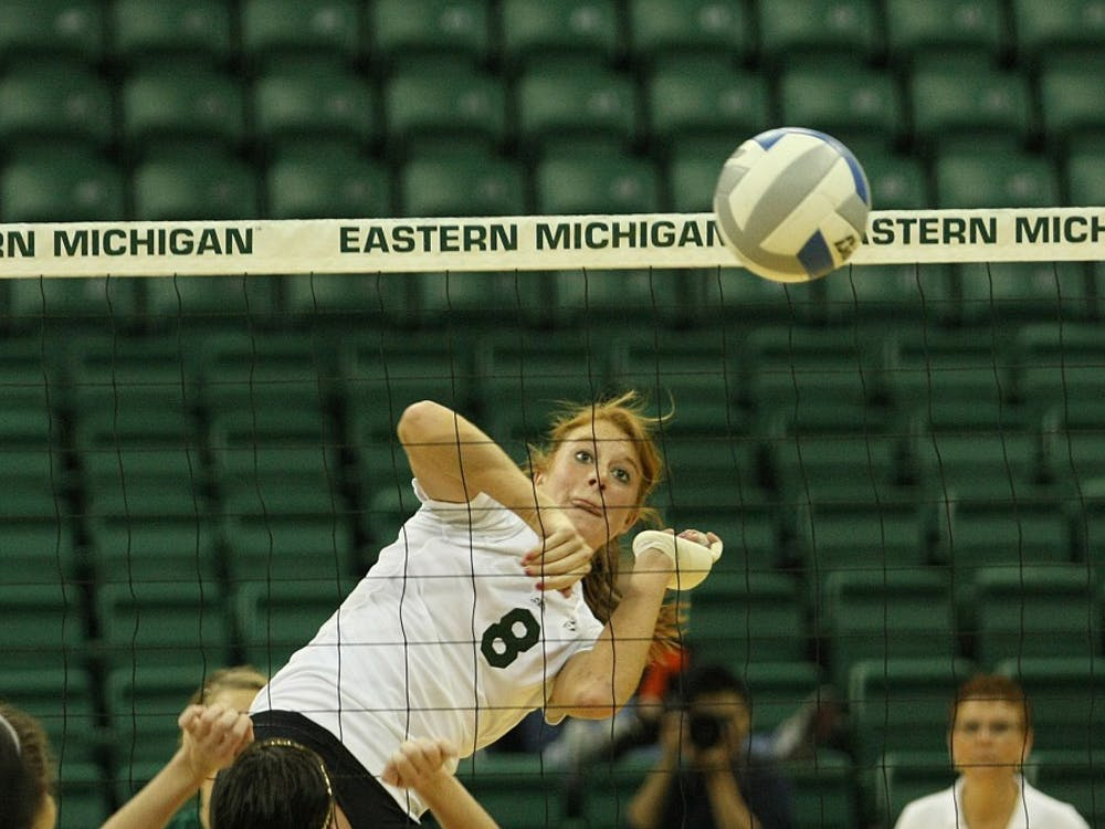 Senior Victoria Randolph spikes the ball Saturday against Western Michigan. She and fellow senior Kim Jarzynka played their final home match at the Convocation Center, but will continue their collegiate careers in the MAC tournament Tuesday.