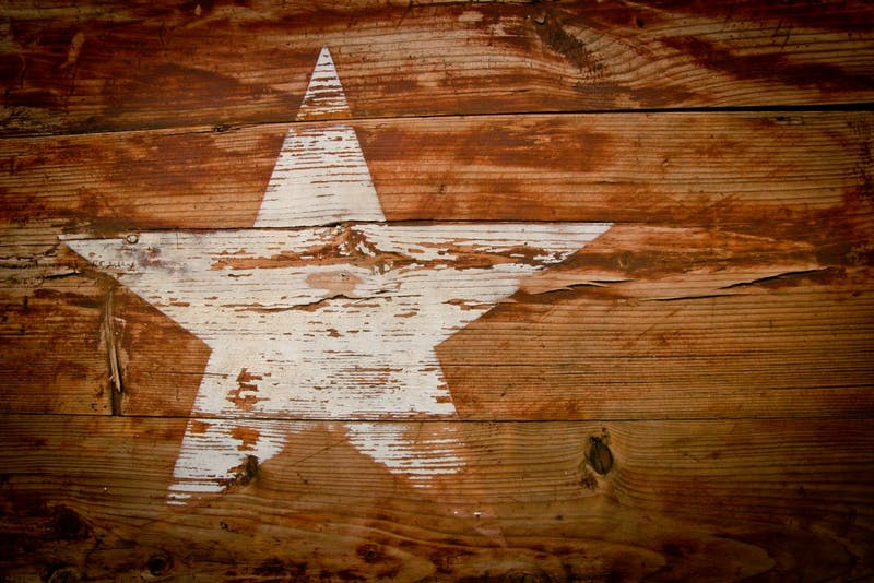 A brown and white wooden star print board. Photo by Glen Carrie on Unsplash.