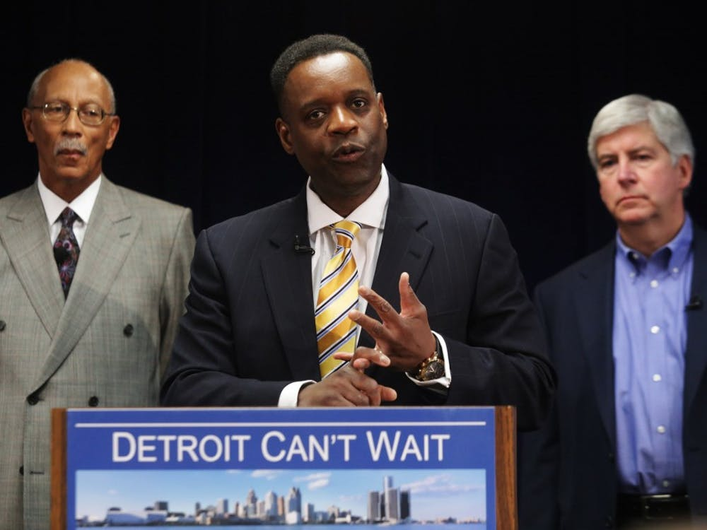 Washington, D.C. lawyer Kevyn Orr, 54, center, addresses the media at the Cadillac Center in Detroit, Thursday, March 14, 2013, after being named as a candidate by Governor Rick Snyder as the emergency financial manager for the city of Detroit. (Ryan Garza/Detroit Free Press/MCT)