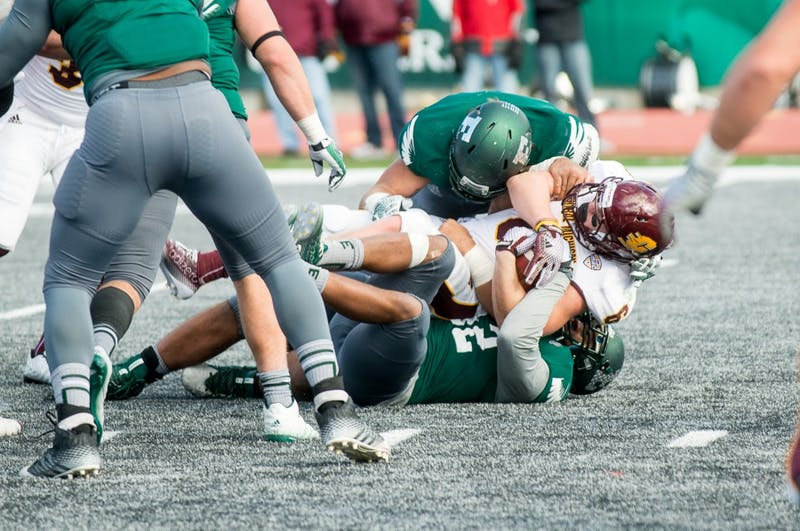 Central Michigan's running back gets tackled by Eastern Michigan on Nov. 1 at Rynearson Stadium.