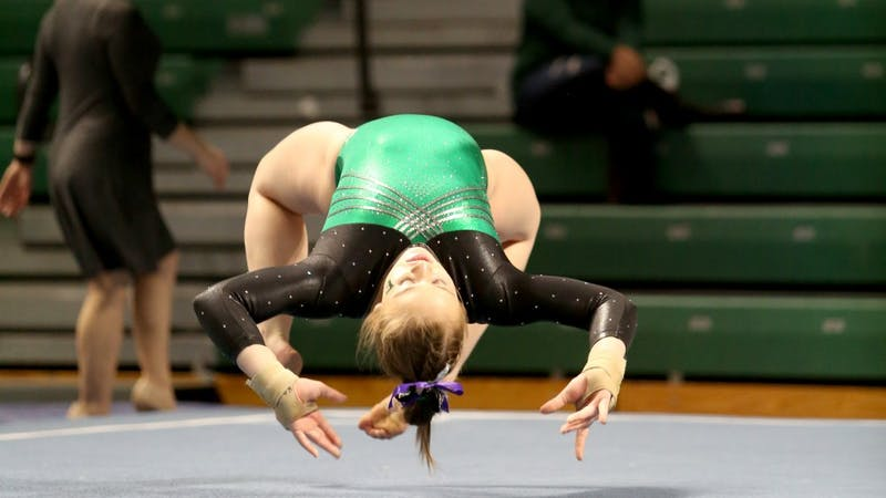 Kirsten Gendron competes against Towson at the Convocation Center on Feb. 20, 2017.