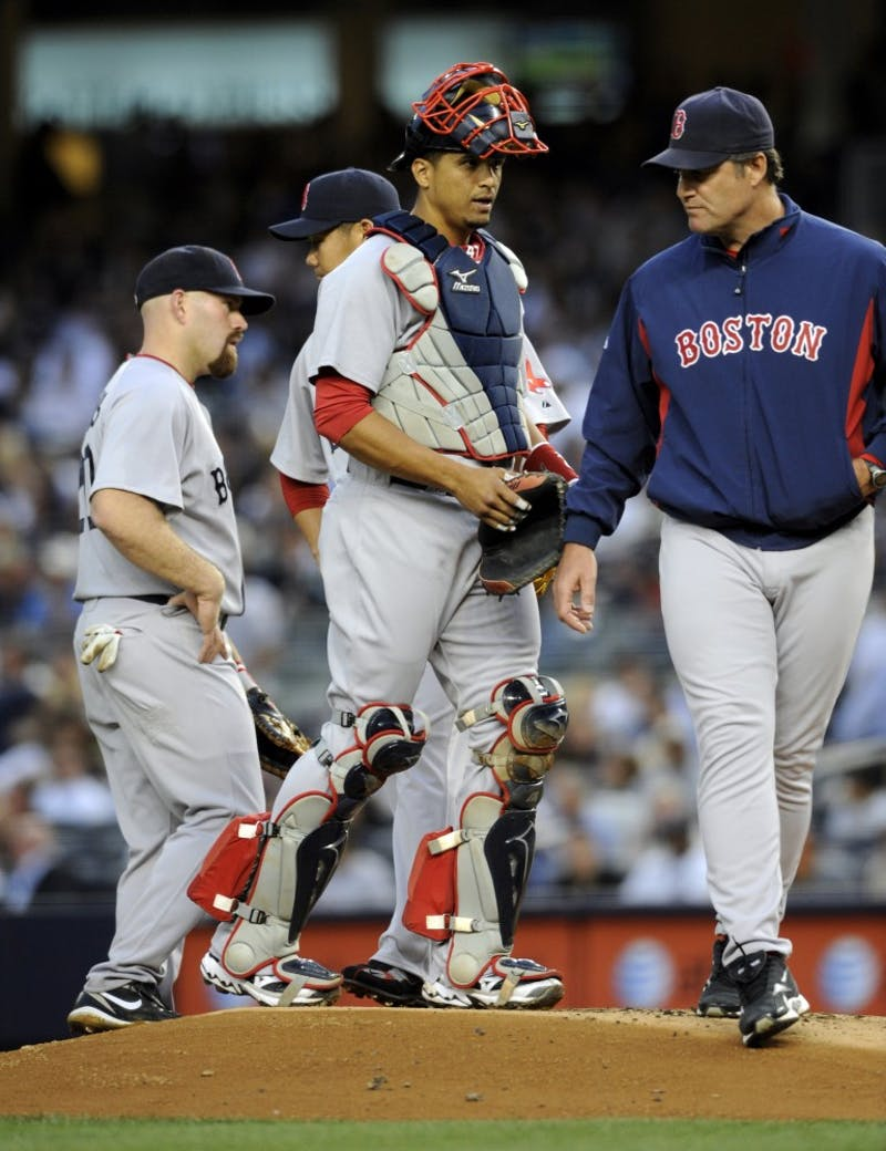 Former Boston Red Sox catcher Victor Martinez walks back to the plate after visiting pitcher Daisuke Matsuzaka in the first inning at Yankee Stadium. Martinez has landed a position at the Detroit Tigers, and will add to the offensive strength, currently lacking in the team.