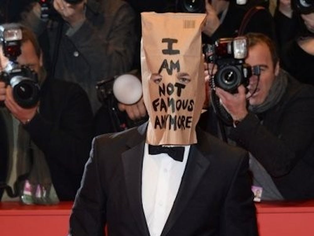 Shia LaBeouf wears a paper bag on his head expressing his displeasure with the press following his every move. Photo by Jenn Selby on Independent