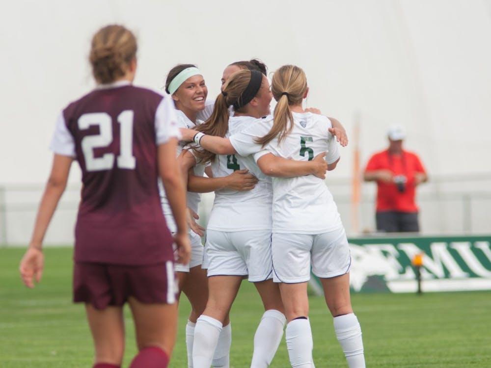 Eastern Michigan women's soccer team celebrates on Sept. 17.