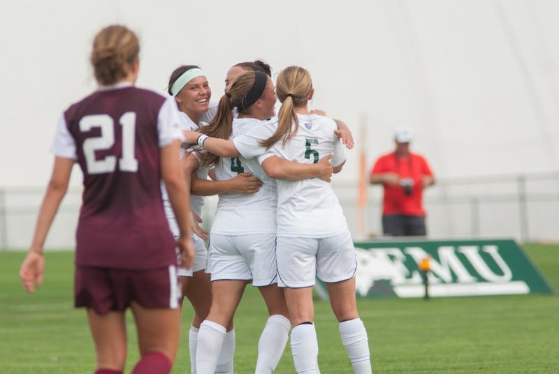 Eastern Michigan women's soccer team celebrates on Sept. 17.