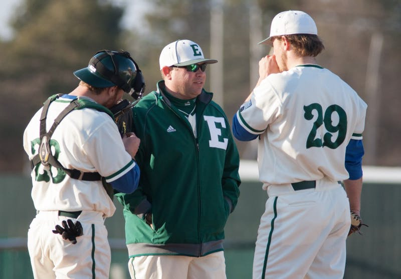 Eastern Michigan pitching coach Eric Peterson chats with Paul Schaak in the Eagles 5-3 loss to the Michigan State Spartans Tuesday night.
