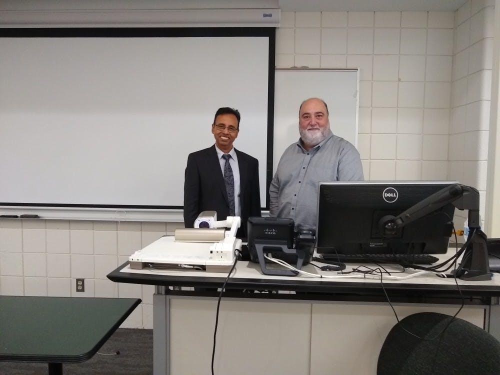 Robert Kraemer, co-founder of Kraemer Design Group, posing with Sanjib Chowdhurry, Director of Center of Entrepreneurship.