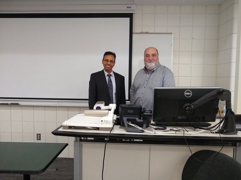 Robert Kraemer, co-founder of Kraemer Design Group, posing with Sanjib Chowdhurry, Director of Center of Entrepreneurship.