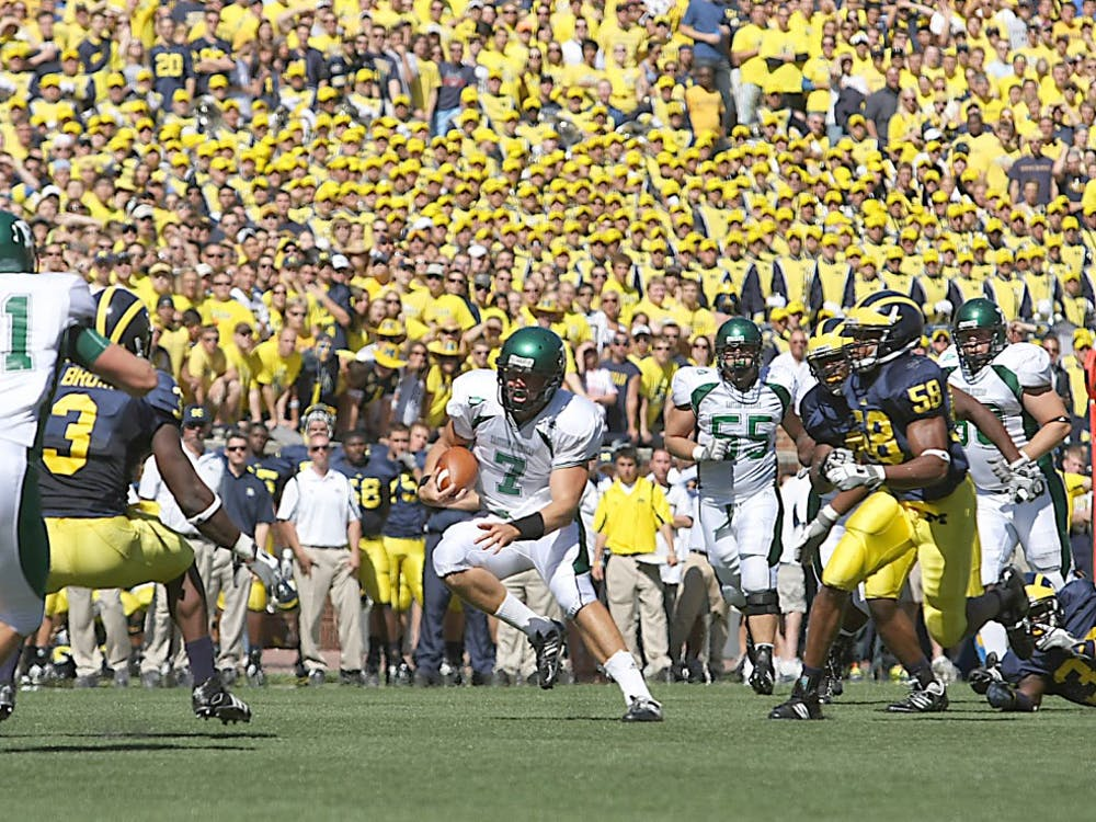 Andy Schmitt (7) runs on Saturday against Michigan.  He later left during the fourth quarter with a season-ending knee injury.