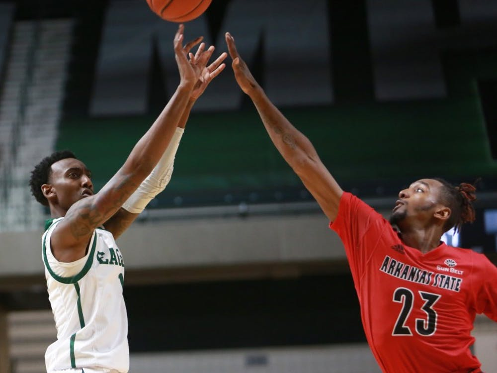 Tim Bond shoots the ball during the game against Arkansas State at the Convocation Center in Ypsilanti