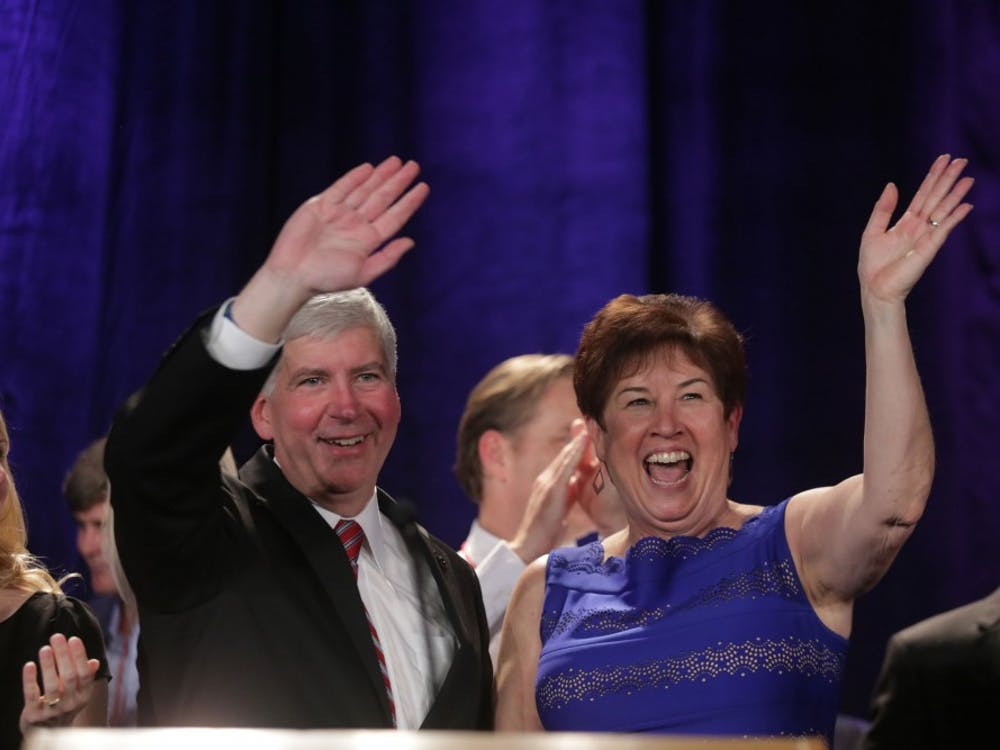 Michigan Gov. Rick Snyder and his wife Sue Snyder wave to crowd following his victory speech during the Michigan Republican Party Statewide Election Night party in the Renaissance Ballroom of the Detroit Marriott at The Renaissance Center in downtown Detroit on Tuesday, Nov. 4, 2014. (Ryan Garza/Detroit Free Press/MCT)