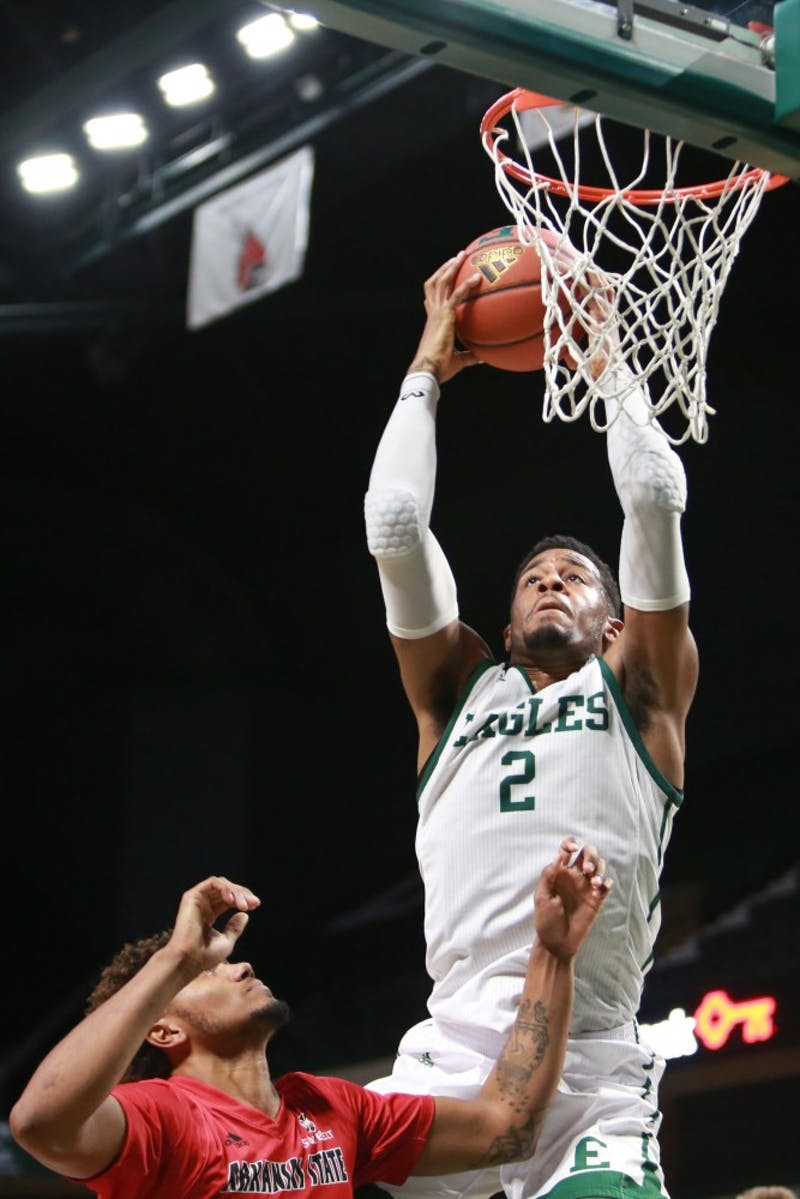 James Thompson IV dunks the ball during the game against Arkansas State at the Convocation Center in Ypsilanti