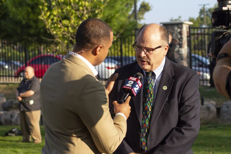 EMU President James Smith being interviewed by FOX 2 news at the 9/11 ceremony of remembrance, to honor the lives that were lost, as well as the lives of the survivors. It was his fourth time attending the ceremony.