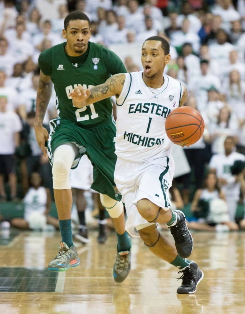 EMU guard Mike Talley drives past Ohio forward John Smith (21) in Eastern Michigan's 58-56 loss to Ohio Saturday.