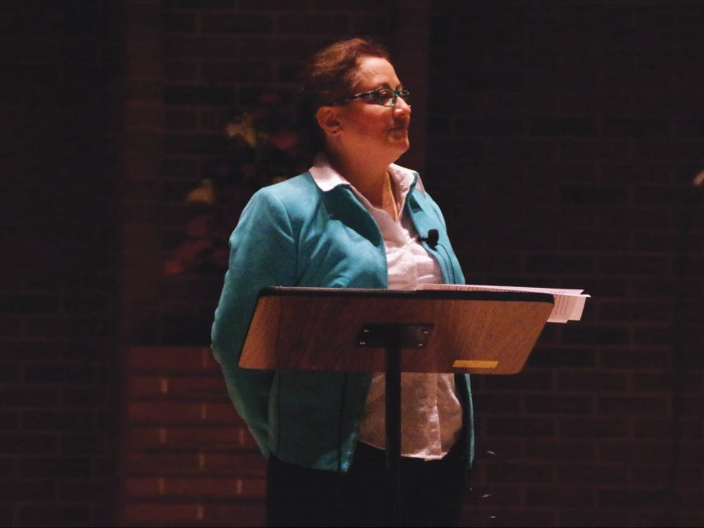 "Dr. Yvette Colon, assistant professor at the EMU school of social work, speaking at the third installment of the EMU Honors College Star Lecture Series on Tuesday, Dec. 6. The central topic of the 2016-2017 series is ""With Justice For All?"" and Colon discusses chronic pain and a flawed United States healthcare system."