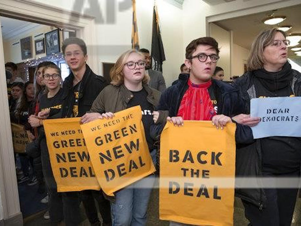 Environmental activists occupy the office of Rep. Steny Hoyer, D-Md., the incoming majority leader, as they try to pressure Democratic support for a sweeping agenda to fight climate change, on Capitol Hill in Washington, Monday, Dec. 10, 2018. (AP Photo/J. Scott Applewhite)