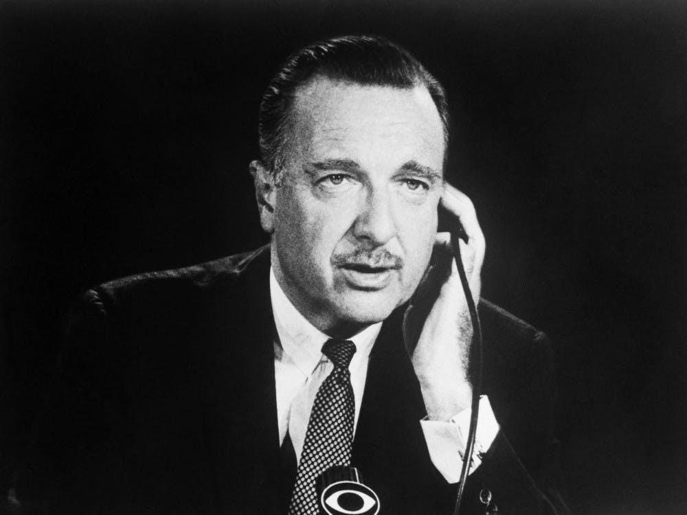 CBS news broadcaster Walter Cronkite is shown here seated in the studio. Dušan Savić | Flickr