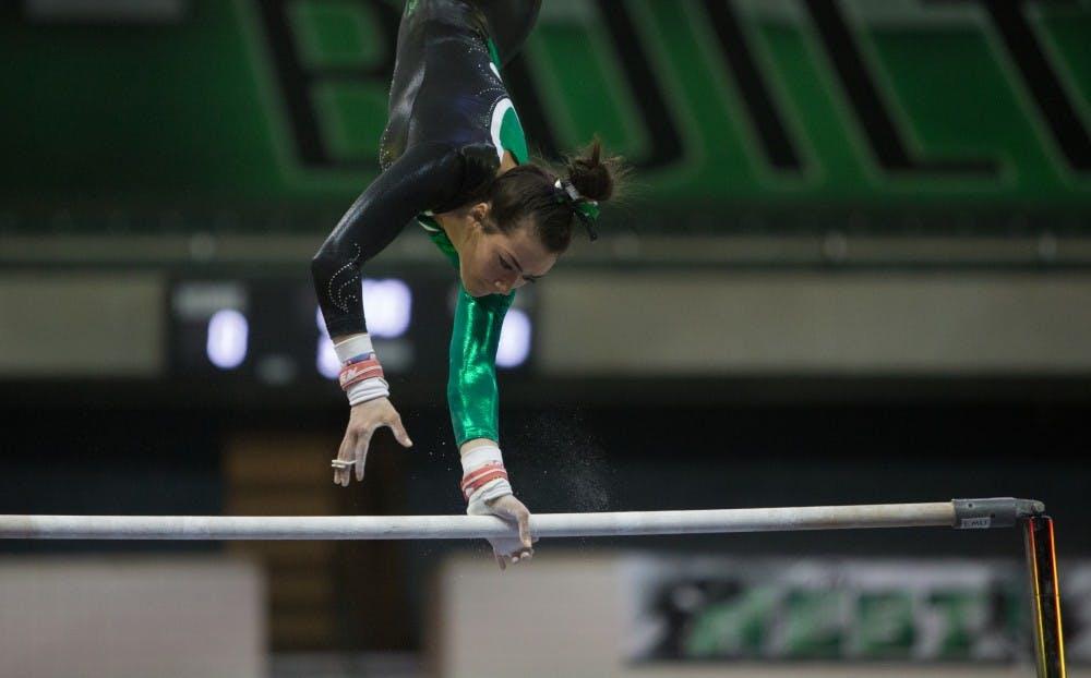 EMU gymnastics breaks program record score; defeats CMU