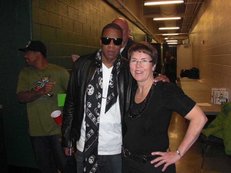 EMU President Susan Martin poses for a picture with rapper Jay-Z after Wednesday's show at the Convocation Center.