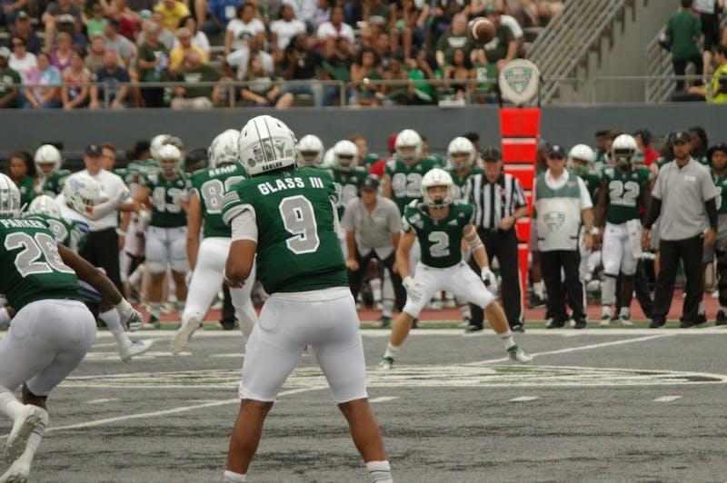 EMU quarterback Mike Glass III throws ball to Mathew Sexton on a screen pass at Rynearson Stadium on Sept. 21.