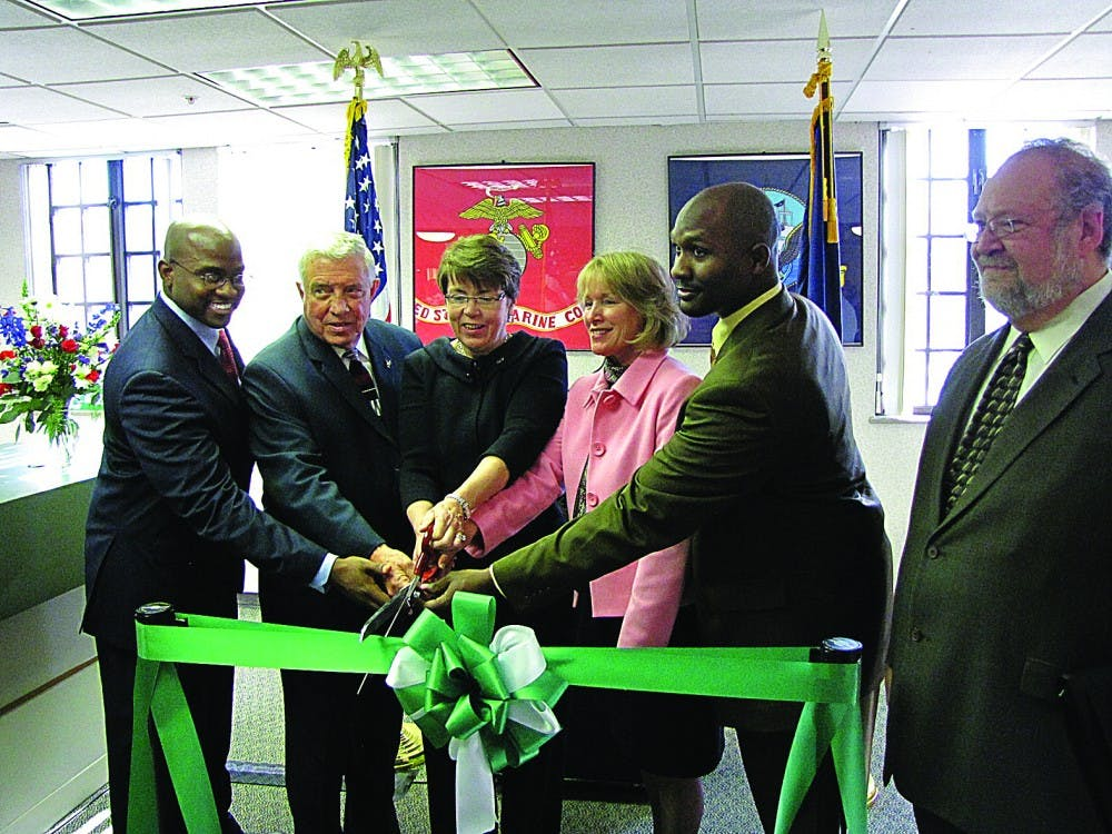 From left, Melvin Kearney, Gary Hawks, Sue Martin, Bernice Lindke, Shaftone Dunklin and Jack Kay gather at McKenny Hall to celebrate the grand opening of the Veterans Services Office.