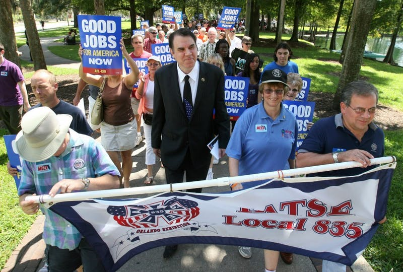 Congressman Alan Grayson walks with union members during the AFL-CIO Labor Day Jobs Rally, at Lake Eola Park in downtown Orlando, Florida, Monday, September 6, 2010.