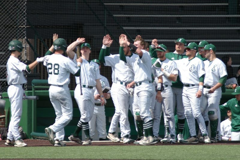 The EMU baseball team celebrates a run scored on April 7 at Oestrike Stadium.