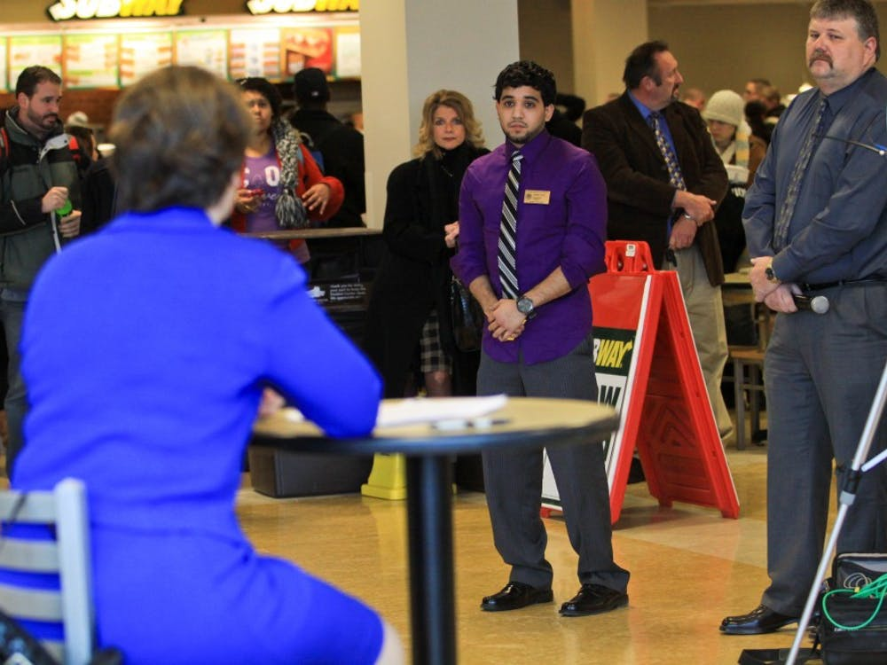 Various campus officials stand by to assist in the question and answer session held in the Student Center food court.
